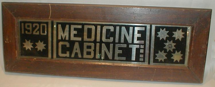1921 Medicine Cabinet mirrored signed in frame. 21.25 x 8.25
