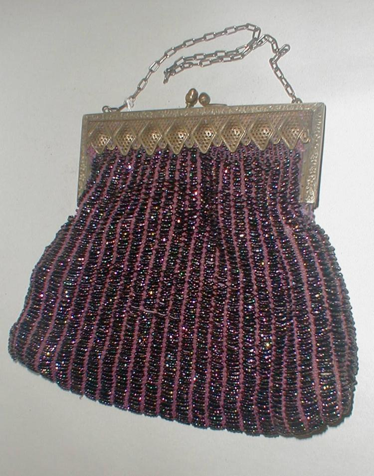 Deco Handbag with filigree clasp, beaded with iridescent purple glass beads - Note hole in side, solder repair on clasp