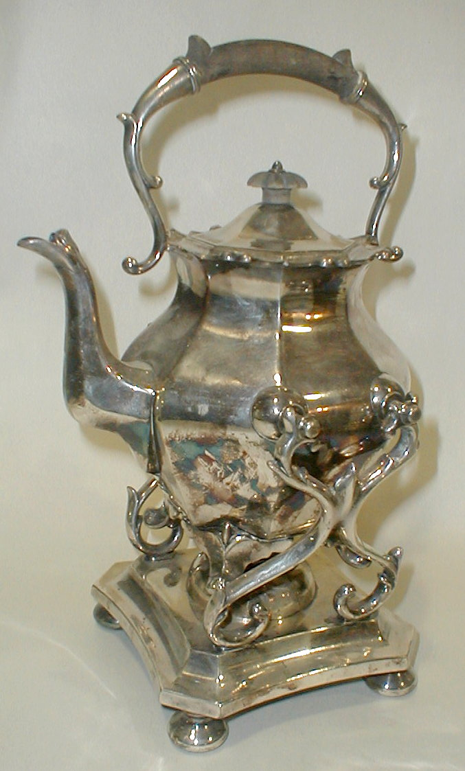 Old Reed & Barton silver plate tilting teapot on stand. Ordinary wear from use