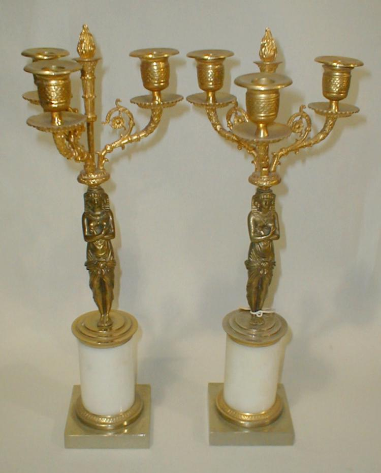 Pair of French three arm Candelabra with Egyptian figural stems, on alabaster base. 2nd half 20th century. 17
