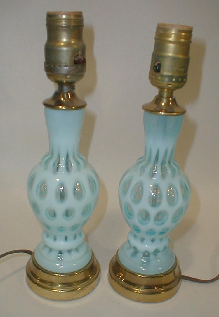 Pair of Fenton Blue Thumbprint Glass bedroom lamps. Overall height 11