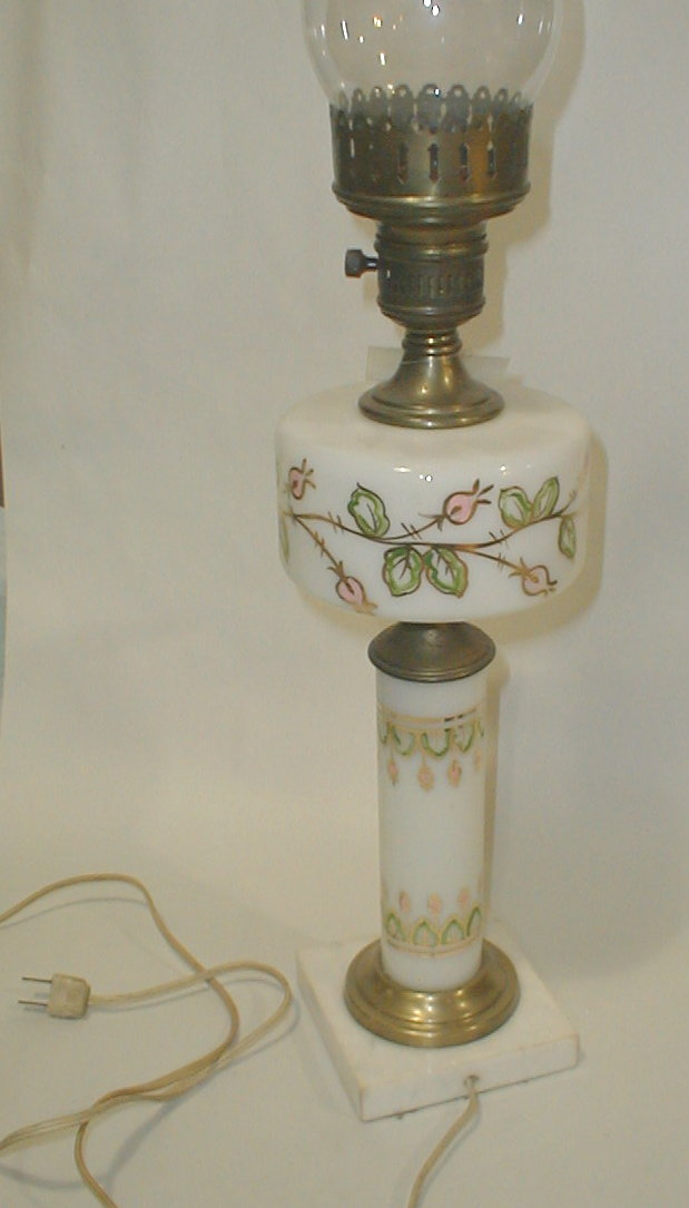 Hand painted milk glass Lamp on white marble base. Height excluding chimney is 18