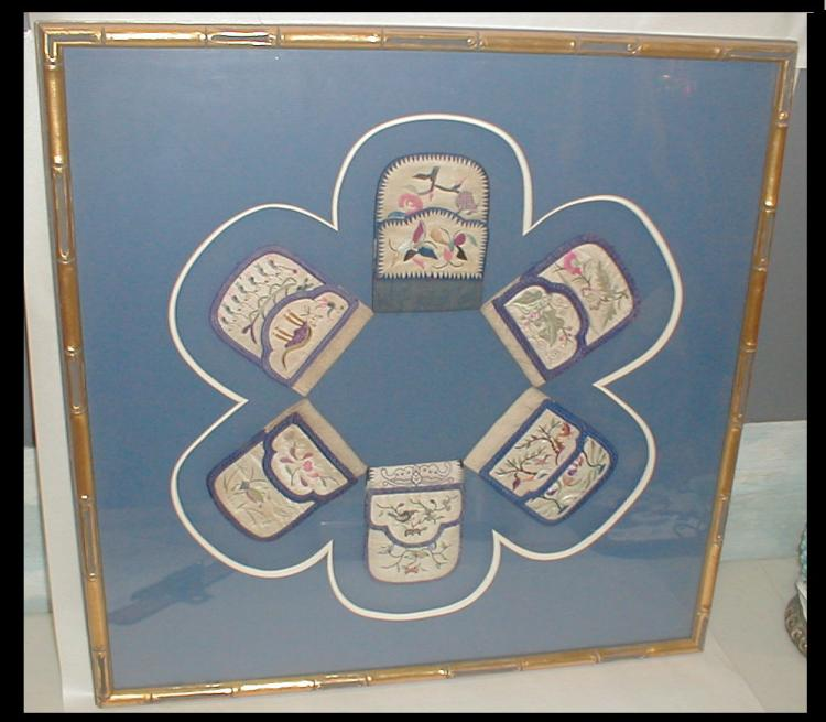 Collection of Chinese Textile Pouches silk embroidery displayed in a 22 1/4 x 22 1/4 frame