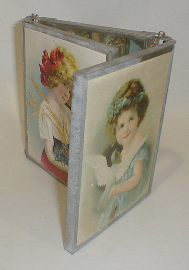 Child's three panel vanity mirror with two stone litho prints of girls with flowers. Made in Germany. 6 3/8