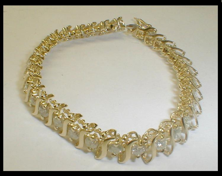 Yellow gold and diamond bracelet. Has 31 stones approximately 3.65 mm, Mostly I1-I3. DTW approximately 5.58 cts. Has current Appraisal for $6,620.00