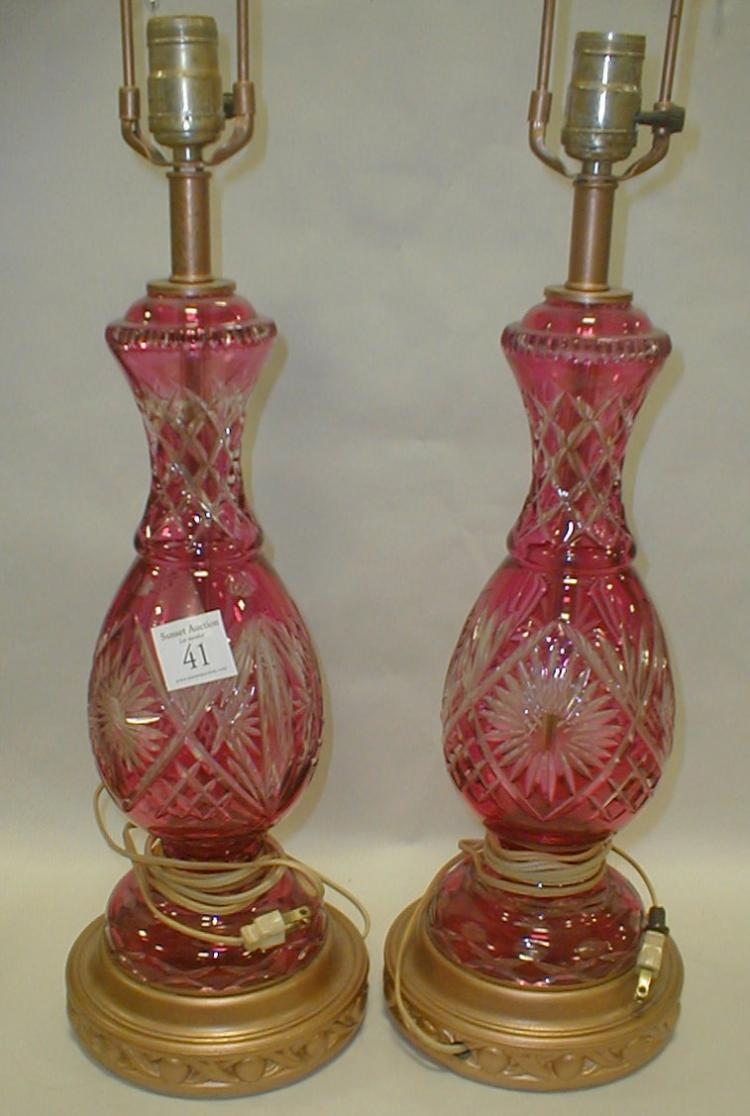 Pair cranberry cut to clear glass table lamps. Height to tip of socket 21