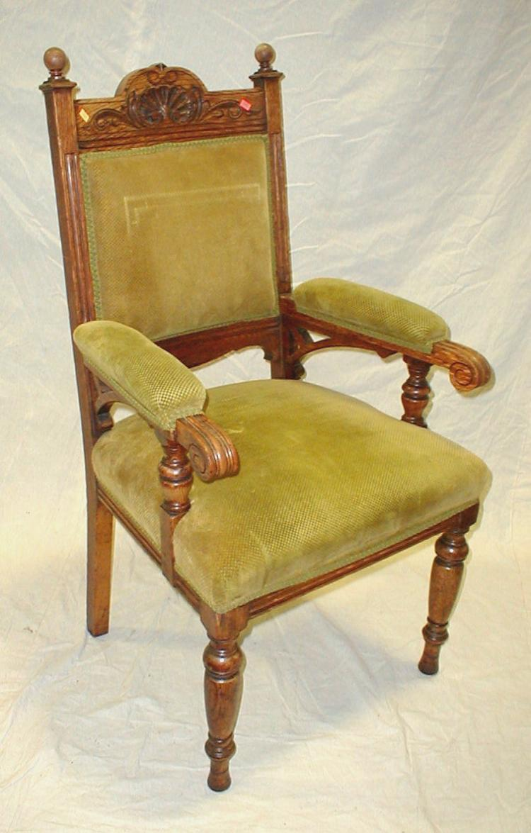 Gentleman's antique carved oak arm chair