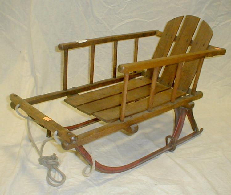 Primitive child's sled. Made of wood slats on metal runner. 25