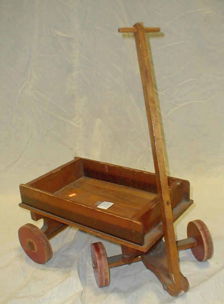 Primitive toy wood wagon: made from assorted woods including oak flooring and an oil crate. Approximately 21