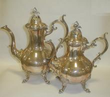 Two contemporary Reed & Bart silver plated coffee pots.  Neither stands level