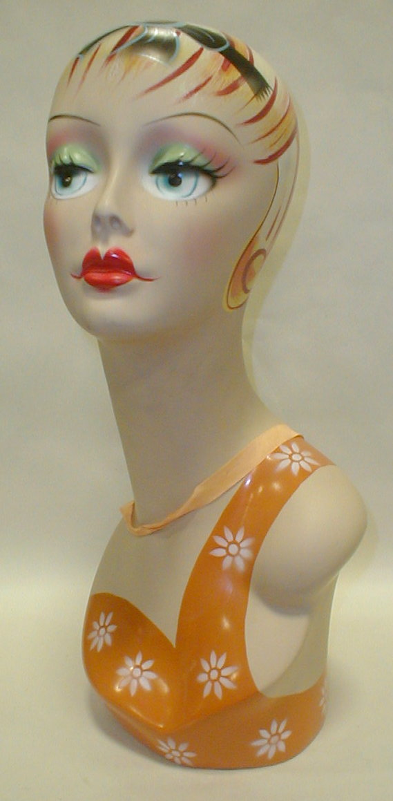 Painted and airbrushed mannequin display head. 18.5