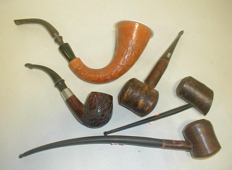 Five estate tobacco pipes. Used