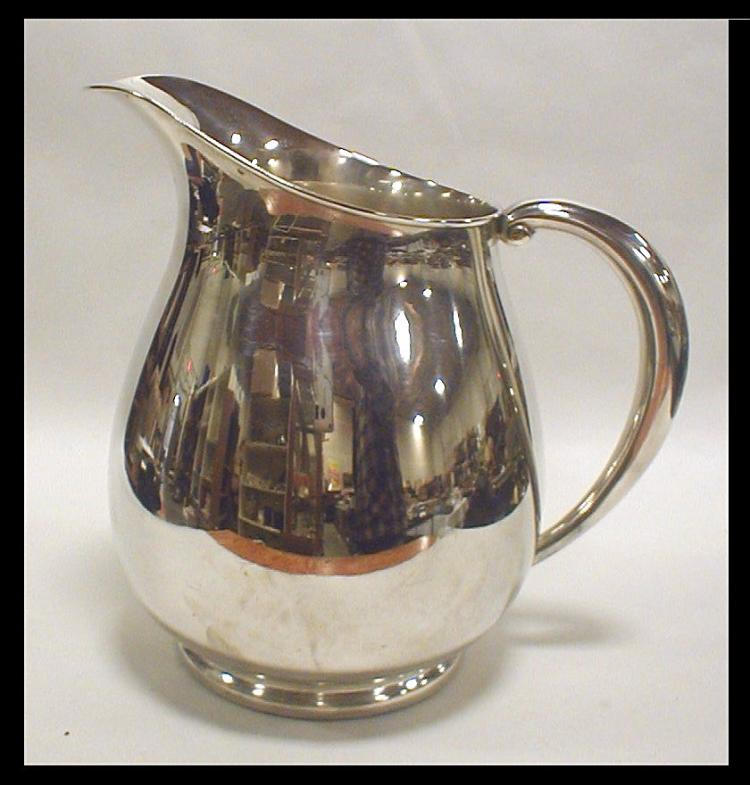 Fisher sterling silver pitcher. 7 7/8