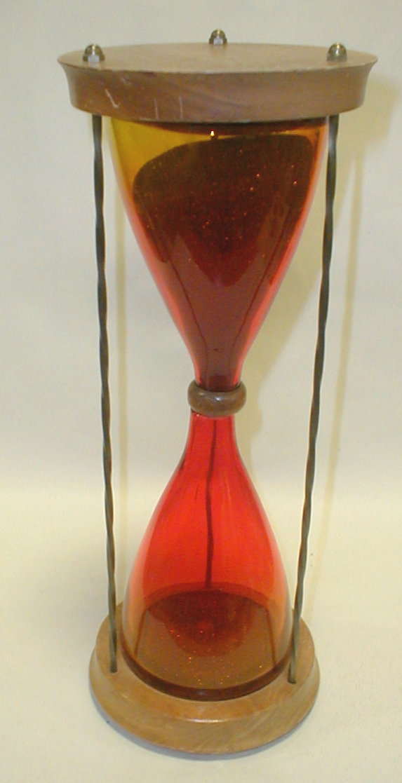 Mid-century hour glass. Walnut ends with spiral metal rods and amberina glass. Blenko ? 13 5/8