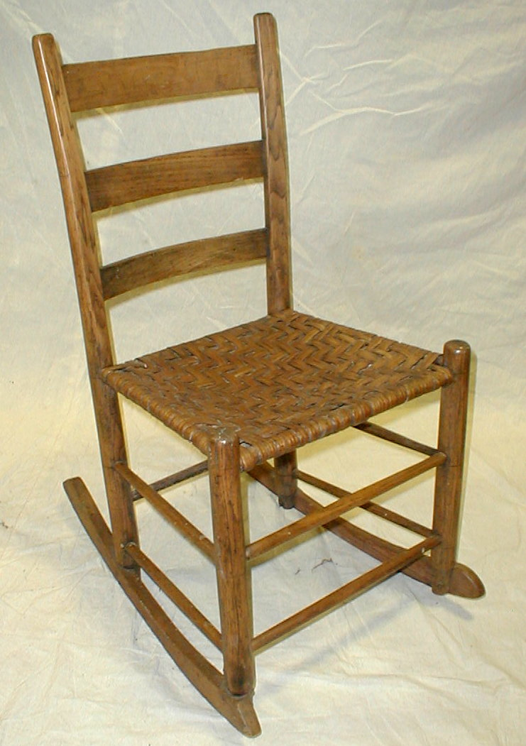 Small 19th century slat back rocking chair with woven reed seat. Note old repairs on leg with screws