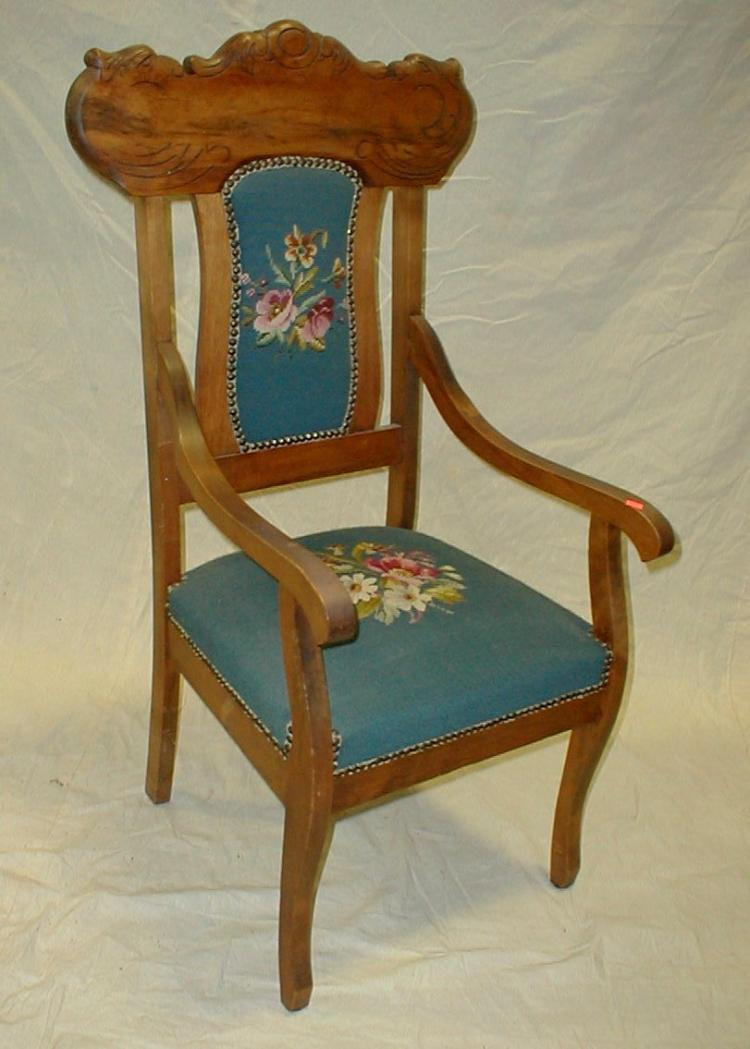 Edwardian period walnut arm chair with needle point upholstery.