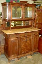 Louis XVI Revival marble top side board with upper hutch and mirrored back. Beveled and curved glass. Solid Walnut with oak interior woods. Minimum bid $500