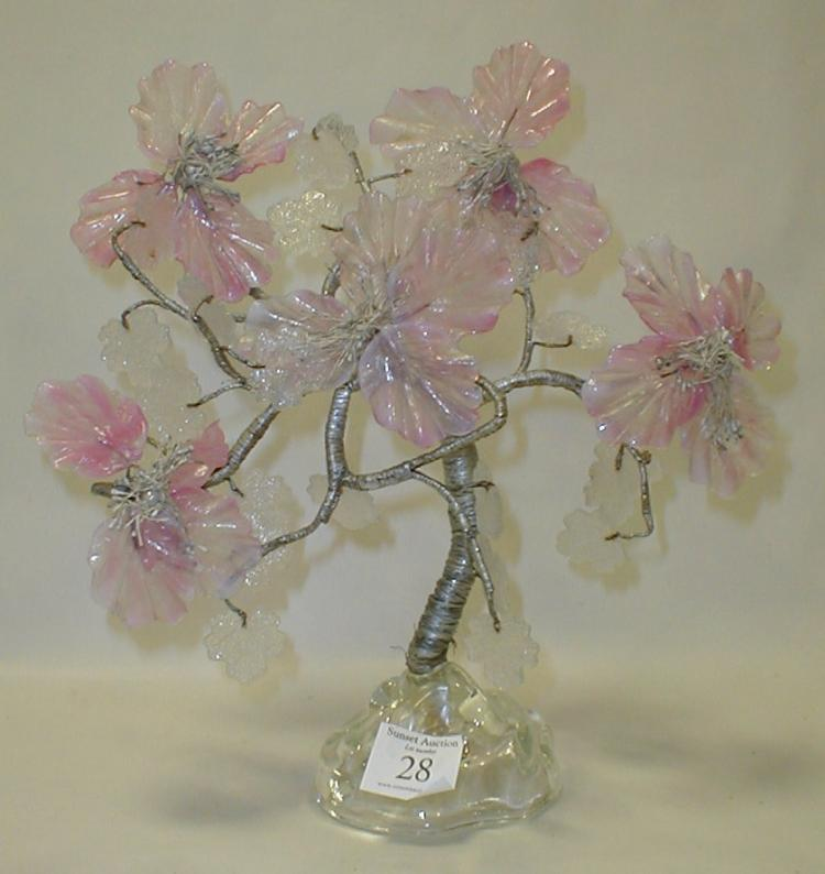 Tree display: trunk wrapped in silver thread with Italian pink glass leaves. 11.5