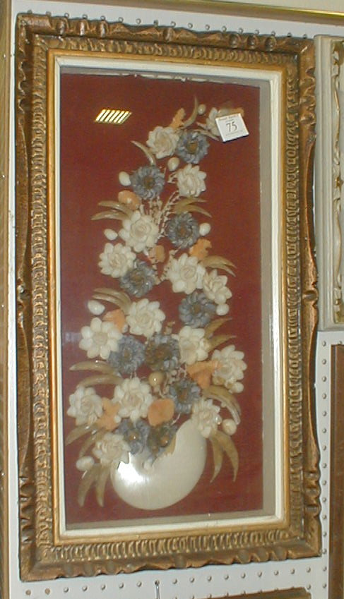 Turn of the century shell art in the form of a floral bouquet. Displayed in shadow box frame.