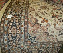 Hand knotted carpet. overall wear mostly on medallion 4'8