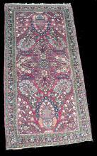 Hand tied carpet. 4'11