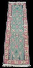 Hand tied runner rug. 8'6