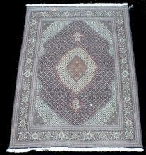 Fine hand tied carpet. 6'7