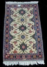 Hand tied carpet. Signature woven in. 60.5