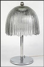 PRESSED GLASS AND METAL TABLE LAMP.