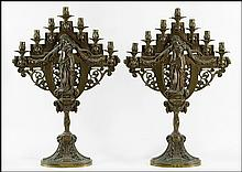 PAIR OF PATINATED METAL SEVEN-LIGHT CANDELABRUMS.