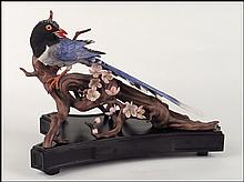 A BOEHM PORCELAIN 'RED BILLED BLUE MAGPIE' FIGURE.