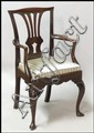 CARVED MAHOGANY OPEN ARMCHAIR.