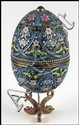 RUSSIAN CHAMPLEVE ENAMEL AND GILT SILVER EGG.