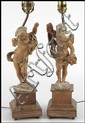 PAIR OF PARCEL GILT CARVED FRUITWOOD CHERUB TABLE LAMPS.