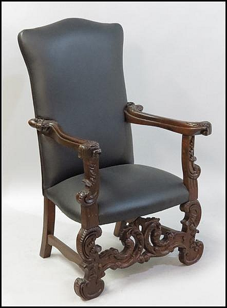 SET OF EIGHT LEATHER UPHOLSTERED CARVED MAHOGANY OPEN ARMCHAIRS.
