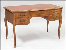 FRENCH PROVINCIAL STYLE CARVED WALNUT WRITING DESK.
