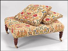 FLORAL UPHOLSTERED OTTOMAN.