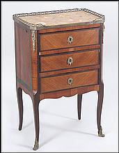 A FRENCH LOUIS XVI ORMOLU MOUNTED MARBLE TOP COMMODE.