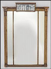 AN EARLY 19TH CENTURY EMPIRE GILTWOOD MIRROR.