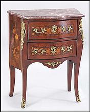 A FRENCH LOUIS XV STYLE ORMOLU MOUNTED MARBLE TOP BOMBE COMMODE.