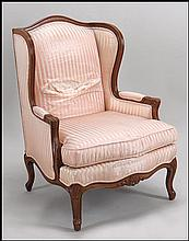FRENCH UPHOLSTERED WALNUT ARMCHAIR.