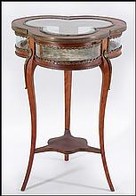 CONTINENTAL TREFOIL FORM CURIO TABLE.