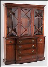 GEORGE III STYLE CHERRY BREAKFRONT SECRETARY.