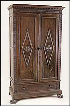 NORTHERN ITALIAN RENAISSANCE REVIVAL CARVED WALNUT ARMOIRE.