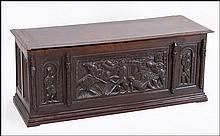CARVED OAK CHEST.