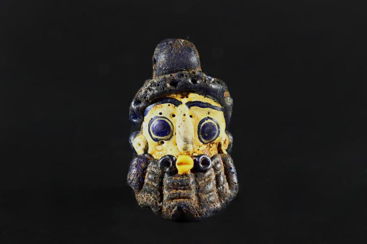 A Colorful Poenicians Bead with Head Carving - Warrior States Dynasty