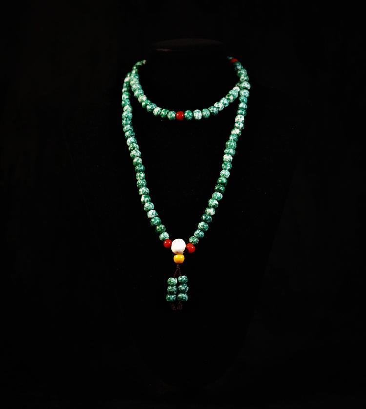 A Tibetan Forg Skin Colored Glaze Bead - Qing Dynasty