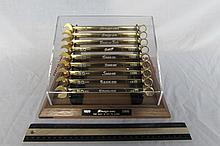 SNAP ON 80TH ANNIVERSARY COMBINATION WRENCH SET 9-PC SET,24KT GOLD PLATED, SHOWING THE NINE CORPORATE LOGO CHANGES OF 1923, 1939, 1950, 1953, 1981, AND 1995, IN A COVERED OAK DISPLAY CASE