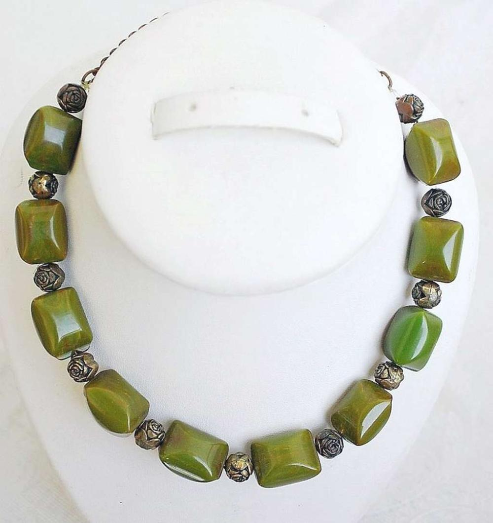 Art deco green carved Bakelite and brass beads necklace, tested.