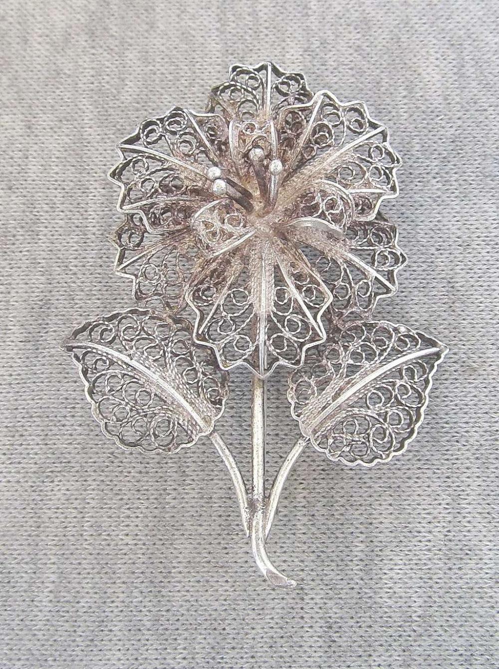 Vintage filigree silver sterling flower brooch.